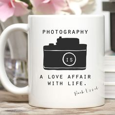 Photography is a love affair with life. -Burk Uzzel - Available in 11 or 15 oz. - Dishwasher and microwave safe - Design is placed on both sides of the mug