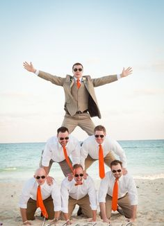 Great idea for the Groom & Grooms men - Groom wears camel colour linen suit with an orange tie whilst the grooms men wear the same shirt & trousers & tie.