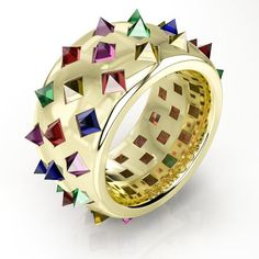 Armoura's spiky Fibonacci ring in yellow gold, with reverse set reverse-set pyramid-cut coloured sapphires and rubies - 42 in total - set into an 18 carat gold band. The new and modern designers who are re-vamping the face of Irish jewellery design: http://www.thejewelleryeditor.com/jewellery/article/the-designers-redefining-irish-jewellery/ #jewelry