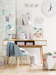 A very calming peaceful office space with a femininel feel. The wood accents look gorgeous with the soft pastel colors.