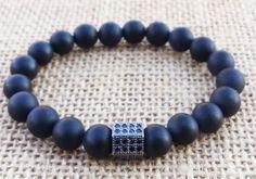 Check out this item in my Etsy shop https://www.etsy.com/uk/listing/291503779/simply-black-mens-bracelet-matte-black