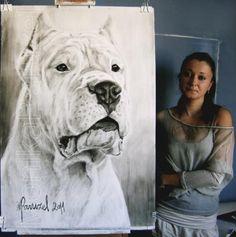 Monika Paruzel est une artiste qui aime peindre les dogos..mais pas seulement....