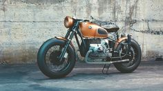 Orange and Black Bmw Motorcycle Before Concrete Wall