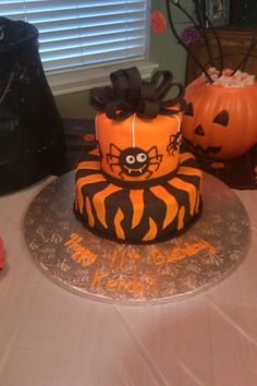 Halloween/Birthday+Cake+-+Fondant+covered+cake+with+fondant+accents.++This+cake+was+designed+around+a+party+napkin.