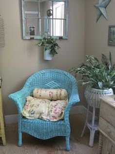 Blue wicker chair and wicker plant stand....