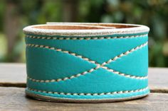 CUSTOM HANDSTAMPED turquoise leather cuff with stitching by mothercuffer on Etsy