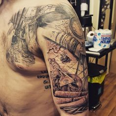 Cool black and grey map half sleeve and chest tattoo I did brokenpuppet