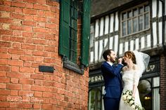 Rustic May Wedding. The happy couple enjoying their day by the Counting House at Avoncroft Museum of Historic Buildings (avoncroft.org.uk). Rob & Sarah Gillespie Photographers.