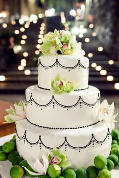 wedding cake- the limes are just the right color to accent the orchids on the cake, beautiful.