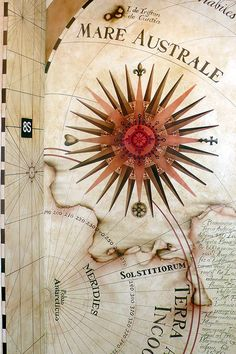 Vintage map murals painted on an entry foyer elevator and ceiling for a nautical themed home on the Gulf of Mexico.