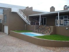 The perfect entertainer's holiday house! This farm-style home offers ample entertainment areas for winter breaks, with a large indoor wood-burning fireplace,  endless dinner table seating,  two lounges, one with a pool table, and a sociable open plan kitchen. For summer breaks, enjoy the covered patio with gas braai, the sun deck, or follow the short path down to the beach. Sleeping 13, this house is ideal for large families, or groups of friends looking for a sociable weekend away. 028 312…