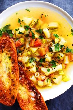 This parsnip and carrot soup recipe incorporates baguette, garlic, parsnips, carrots, leeks, bay leaves, pasta and parsley to create the ultimate comfort food meets fall recipe. Whether you're looking to eat this carrot soup recipe as a cozy fall dinner or pack it for lunch, it's a great choice for a comfort food recipe. #fallrecipes #comfortfood #souprecipes #falldinners #carrotsoup #creamysoup