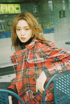 Lee Sung Kyung wears a tartan laminated wool trench coat in the December issue of Marie Claire KR. Photographed by Mok Jung Wook