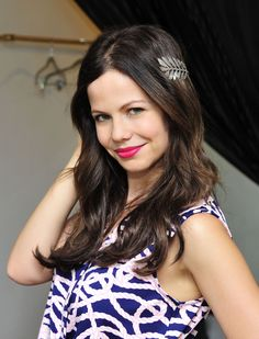 Actress Tammin Sursok flashes trim pins in a shorts jumpsuit and poses against wall of blooming flowers at the Now and Zen PR party in Los Angeles on Thursday. Tammin Sursok, Crop Top Bikini, Short Jumpsuit, Look Alike, Height And Weight, Body Measurements, Bra Sizes, Character Inspiration, Mini Skirts