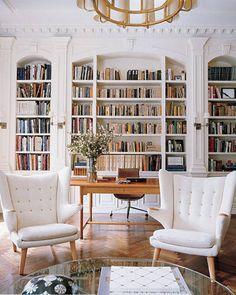 "(via: ELLE Decor) ""A pair of Hans Wegner's Papa Bear chairs flank a Interior Design, House Interior, House, Home Libraries, Elle Decor, Home, Interior, Papa Bear Chairs, Home Decor"