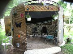 We recycled the trampoline. It's now our trampzebo. Firsts it was fabric walls and now it's lattice. Supported it with concreted in the ground PVC is used to hold it up.