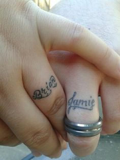 Spouses name under the wedding ring so you can never really take the ring off.