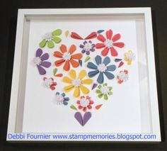 Joanne Walton shared this heart frame    folded hearts to make the flowers.