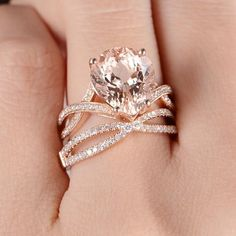 The beautiful ring is a Pear Cut 4.8 ct Morganite ring,It come with matching diamond band.As your engagement ring, it fits perfectly.It's perfect for those who love the 14k Rose Gold and Morganite Engagement Ring Product Introduction *Set in solid 14k Rose Gold Main Stone** *Type:Morganite *Size:10*12 mm *Color:Pink Side Stone** *Type:Diamond *Weight:0.17 Carat *SI-H Natural conflict free diamonds Wedding Band Product Introduction *Set in solid 14k Rose Gold Main Stone** *Type:Diamond *W...