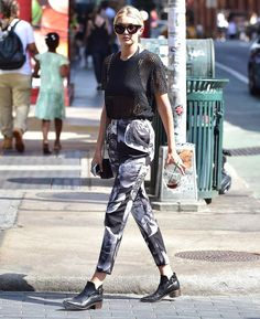 Gigi Hadid's sporty tailored trousers and a mesh t-shirt