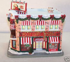 """Holly Leave Market  Hawthorne Coca Cola Holiday Village Detailed Hand-crafted, hand painted sculpture  Limited Edition ~ Sculpture Number B2207 ~ COA Approx Size : 7""""x 7"""" x 5.5"""" ~ For indoor use only"""