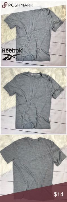 """Men's Reebok Grey Athletic Tee Shirt. Med. Reebok. Men's Medium. Short sleeve athletic tee shirt. Very gently worn, in EXCELLENT condition. No flaws, snags, holes or discoloration. So soft and silky. Looks brand new. Heather grey  100% polyester single jersey fabric Performance material Playdry tech wicks sweat Antimicrobial features Pit to Pit 20"""" Length 26""""  [c28] Reebok Shirts Tees - Short Sleeve"""