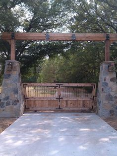 Rustic ranch entrance gate. Stone and timber