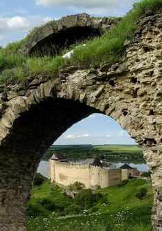 Hotyn Castle, Ukraine. Constructed started  1325 and the castle is located on territory that was historically northern Bessarabia, an region that split in 1940 between Ukraine and Moldova. Legend says the dark spot on the the wall of the castle is from Oksana, who was buried alive in the wall.