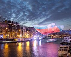 the form of the sculpture by janet echelman, which suspends over amsterdam, has been drawn from the study of earth's interconnected systems. Study Of Earth, Janet Echelman, Downtown Vancouver, Public Realm, Light Reflection, Giza, Stonehenge, Land Art, Australia Travel