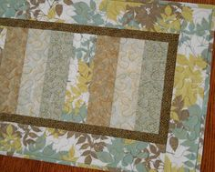 I would love this for my table!  Quilted Table Runner with Leaves and Metallic Gold by susiquilts