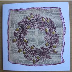 Created with Woodware Rosehip Wreath Stamp using Archival Plum onto old dictionery page highlighted with gold liquid pearls.  www.aldridgecrafts.co.uk