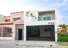 Busca imágenes de diseños de Casas estilo moderno: Casa AT. Encuentra las mejores fotos para inspirarte y y crear el hogar de tus sueños.