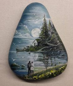 Beach scene with sun and seagulls  painted on a rock.