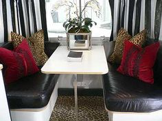 Airstream trailer owned and decorated by Barclay Butera. -love the black/white RV revamp! My hubby wouldn't like the leopard accents ;)