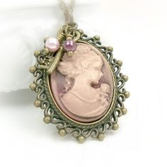 Burgundy Cameo Necklace Antiqued Gold Victorian Lady Cameo Pendant Vintage Style Cameo Jewelry. $28.00, via Etsy.