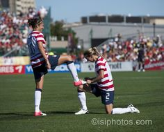 Carli Lloyd and Heather Mitts. (isiphotos.com)ht