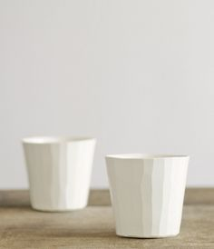 Each cup and plate in Tadamasa Yamamoto's elegant series of semi-porcelain tableware requires a high degree of skill to achieve the uneven sculptured surafce that makes them unique.