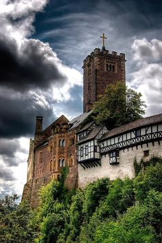 Wartburg Castle in Thuringia, Germany- situated on a 1230-foot (410-m) precipice to the southwest of, and overlooking the town of Eisenach.