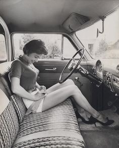 Girl with early car seat belt, ca. 1950s