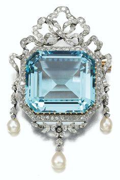 AQUAMARINE & DIAMOND BROOCH   ca. 1915   Foliate & Ribbon Design   centered by a set-cut Aquamarine, seed pearl drops & rose diamonds   French assay marks  