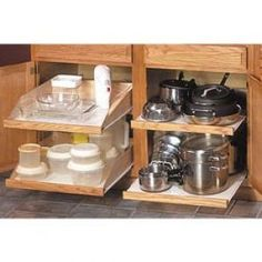 Remodeling your kitchen on a tight budget? Modify existing cabinets to use every inch of space with something like Slide-A-Shelf. Great for pots & pans, holds up to 100lbs each @ LNT.com