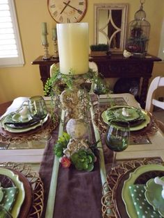 table with nice runner and pillar candlestick centerpiece. Also like the back table a lot too!