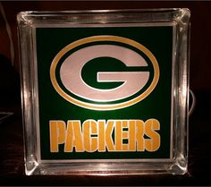 Green Bay Packers lighted glass block with etching and permanent vinyl decoration.  The block is 6 x 6 and comes with a single corded nightlight and on and off switch.   Please specify which design at