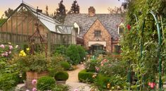 This is such a fantasy-scape. The greenhouse! The abundant roses! The charming little touches everywhere. Who doesn't want to fall into this fairy tale? By Hartman Baldwin Design/ Build in Claremont, CA.