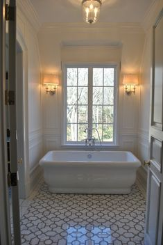 Suzie: The Enchanted Home - Stunning bathroom with marble trellis tiles floor, freestanding ...