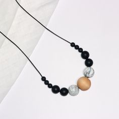 COLOUR: Black, Marble, Wood SILICONE BEAD SIZE: 6 x 9mm round beads, 4 x 15mm round beads, 2 x 20mm round beads, 1 x 25mm round bead. LENGTH: Each necklace is approx 80cm in length. What Mum does not love a stylish fashion accessory? Just because you have a baby does not mean you need to compromise on style. Our silicone jewellery is on trend and not only looks great, the necklaces also provide numerous benefits for fashion conscious mums with bubs. Our silicone teething necklaces ar...