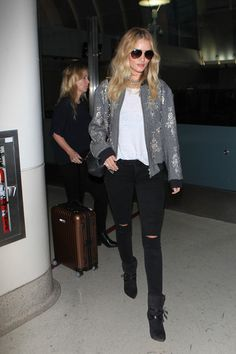 Rosie Huntington-Whiteley is seen arriving at LAX.