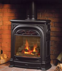 Garage - Valor 530ILN Portrait Engine with 531CSB President Freestanding Gas Stove w/ red brick liner and coal set