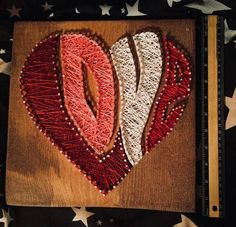 Show the love in your heart! A fun, funky twist on an old favorite. This piece measures approximately 11 x 11 This piece is ready to ship. A custom version can be shipped in 3-5 days. This piece is available complete and ready to hang or as a kit to string yourself. A kit