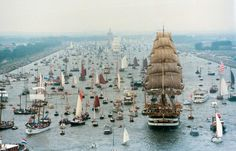 """A flotilla of hundreds of tall ships and other boats sails into Amsterdam for """"Sail Amsterdam"""", the largest free nautical event in the world."""